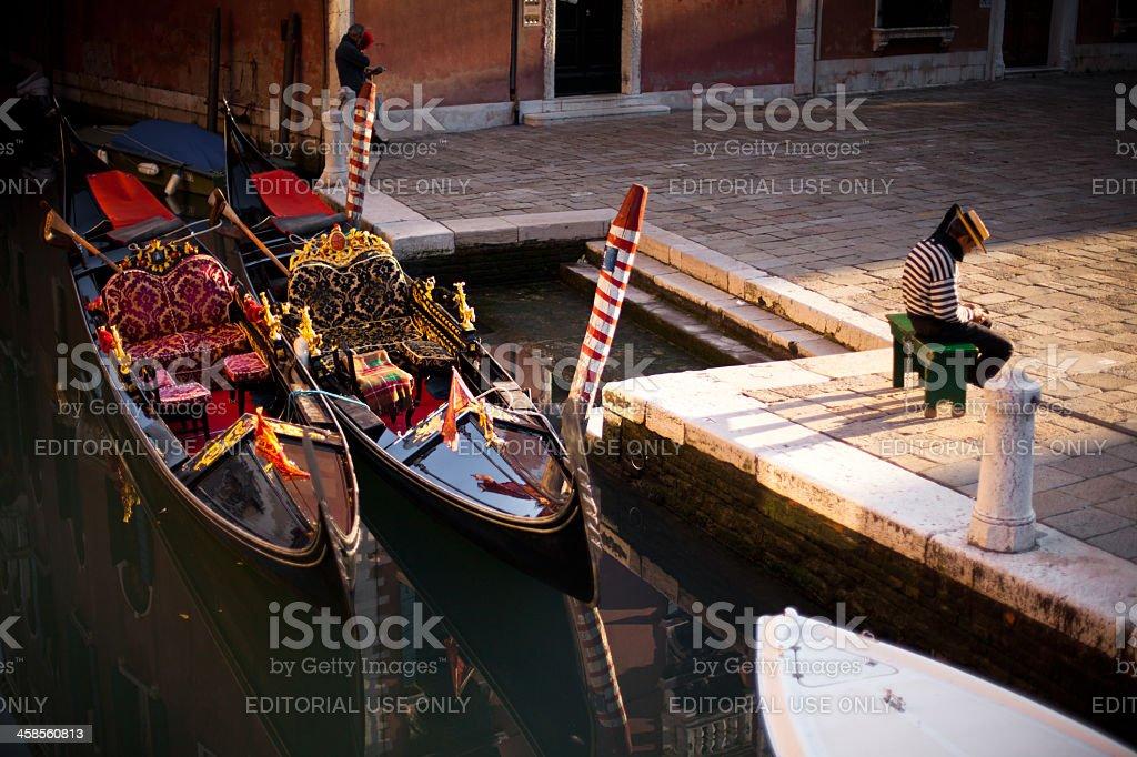 Bored Gondola Captain in Venice, Italy royalty-free stock photo