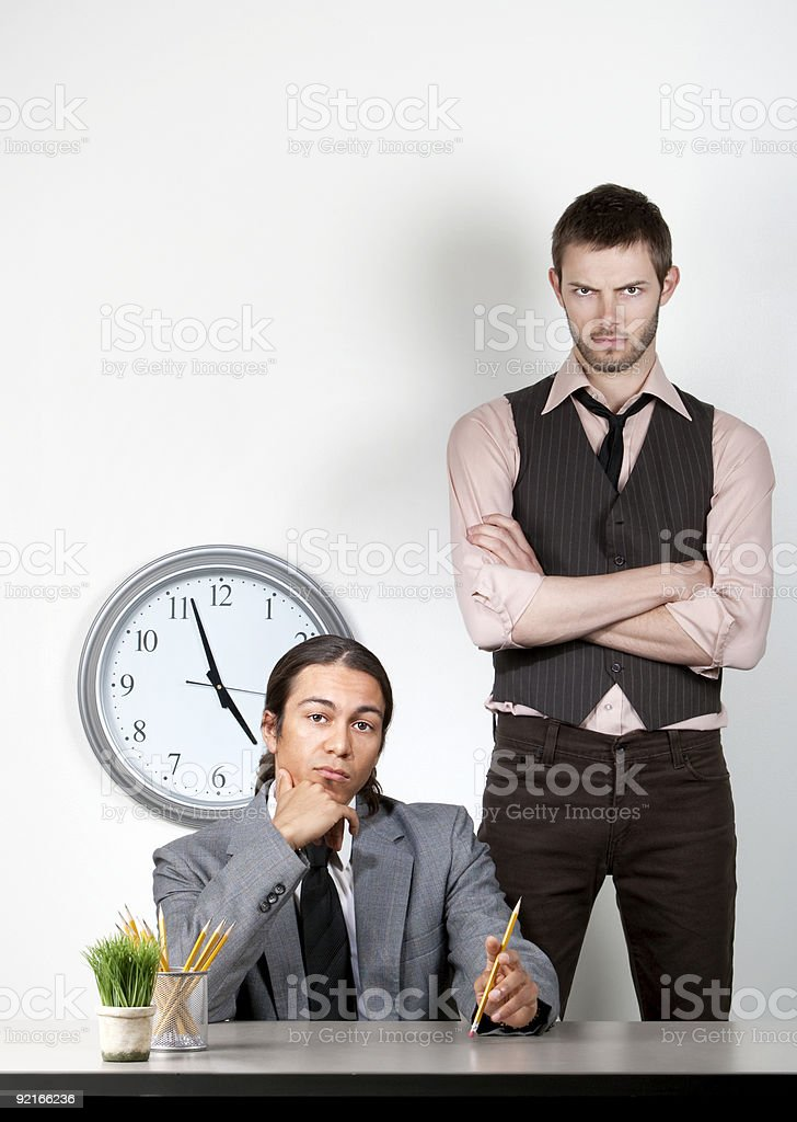 Bored man and angry coworker royalty-free stock photo