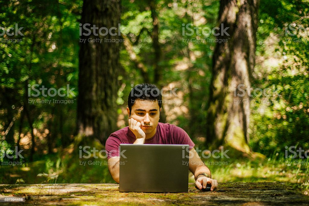 Bored man working outdoors. stock photo
