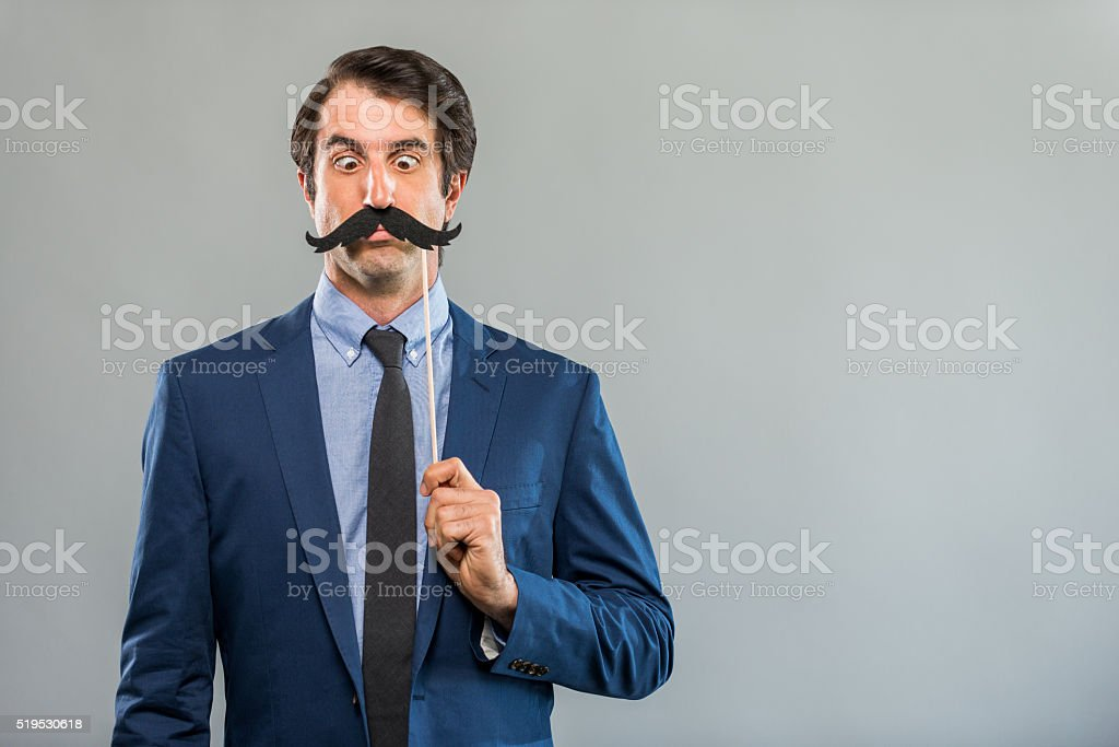 Bored Nerdy Businessman with a Fake Mustache stock photo