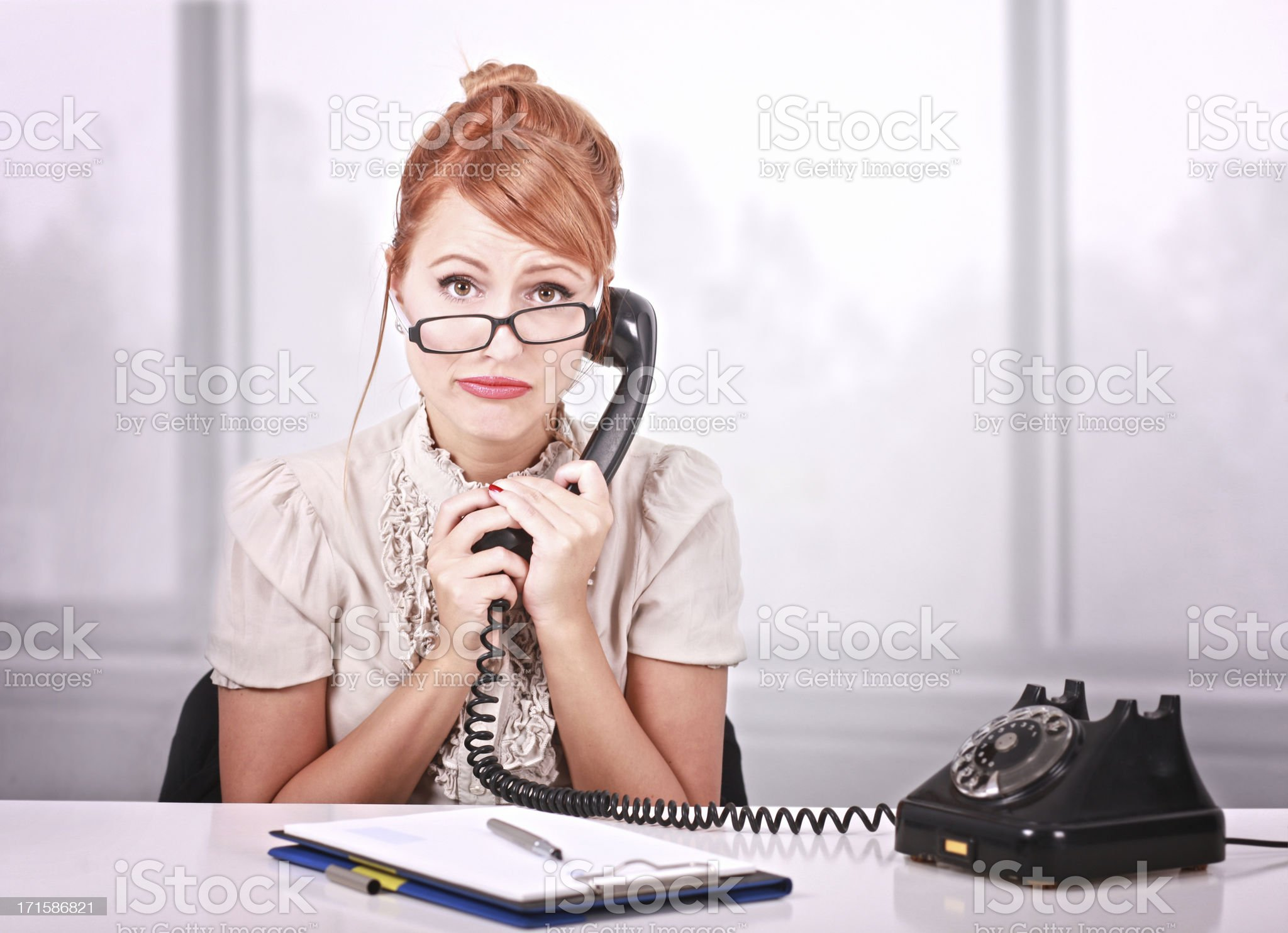 Bored office worker on the phone royalty-free stock photo