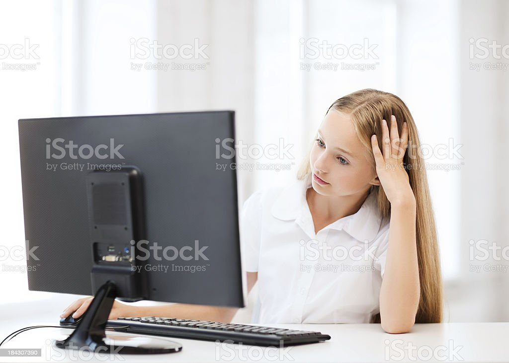 bored student girl with computer at school royalty-free stock photo