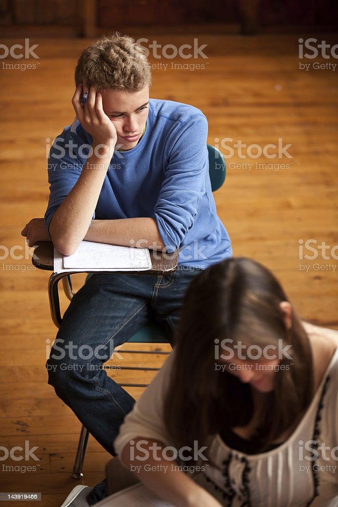 Bored teenage boy in school stock photo