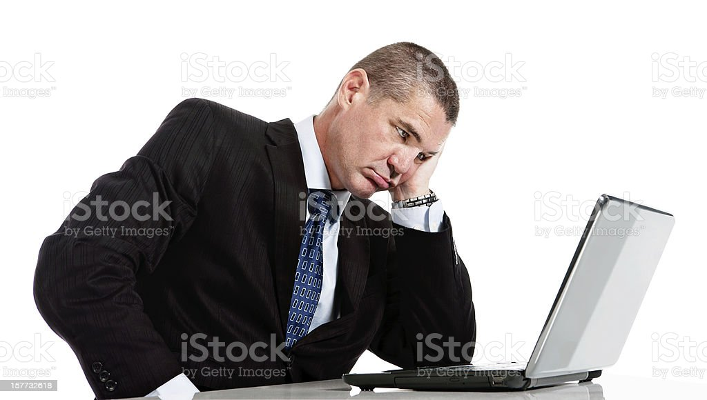 Bored tired and frustrated businessman gets grumpy with laptop royalty-free stock photo