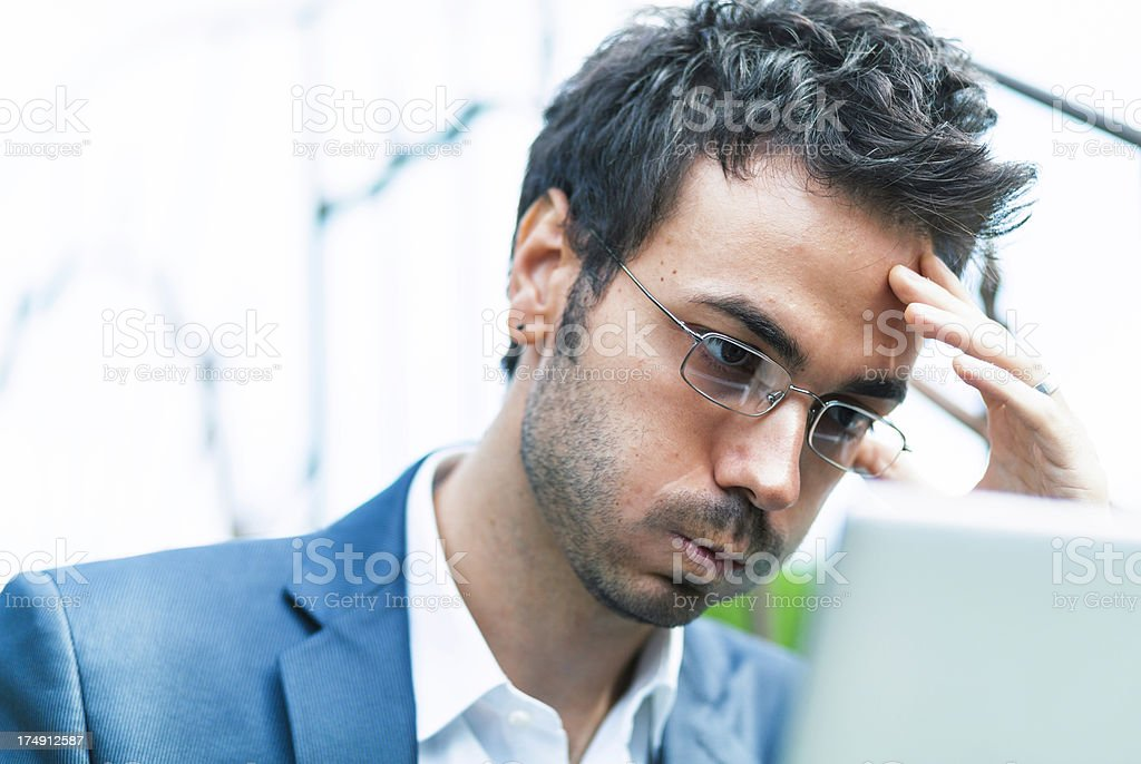 Bored tired and frustrated businessman with laptop stock photo