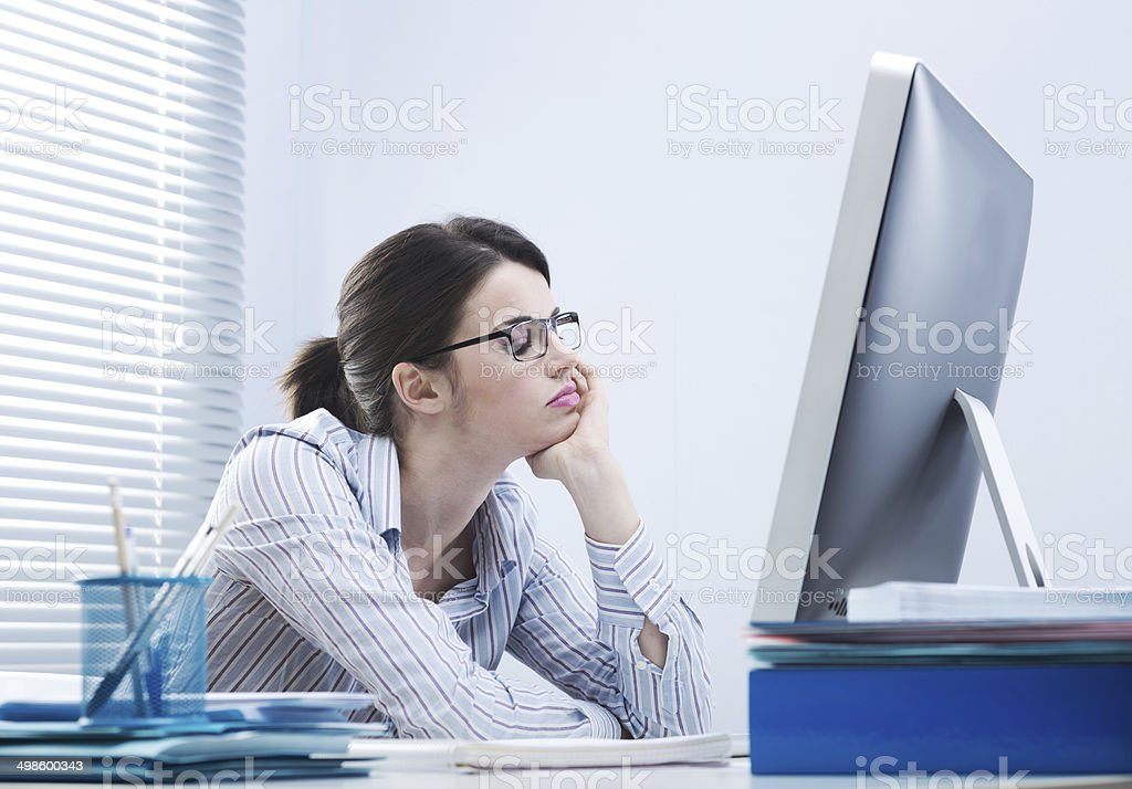 Bored woman at office stock photo