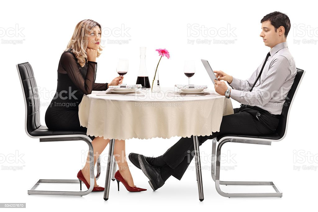 Bored woman on a date with a man stock photo