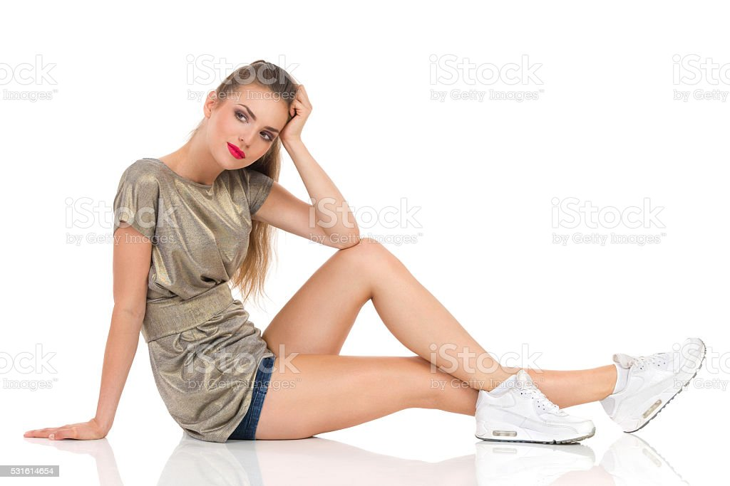 Bored Woman Sitting And Thinking stock photo