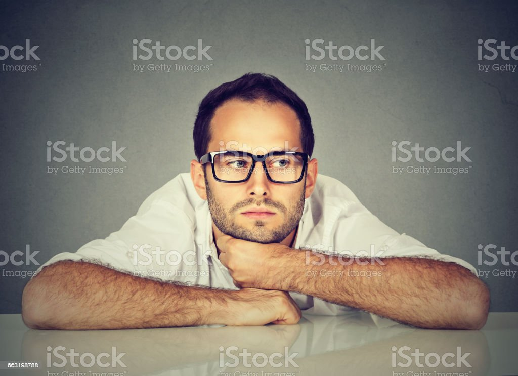 Bored young man daydreaming stock photo