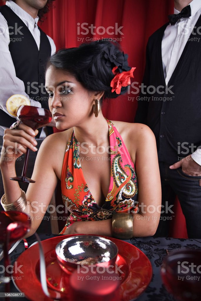 Bored Young Woman Having Drink at Party stock photo