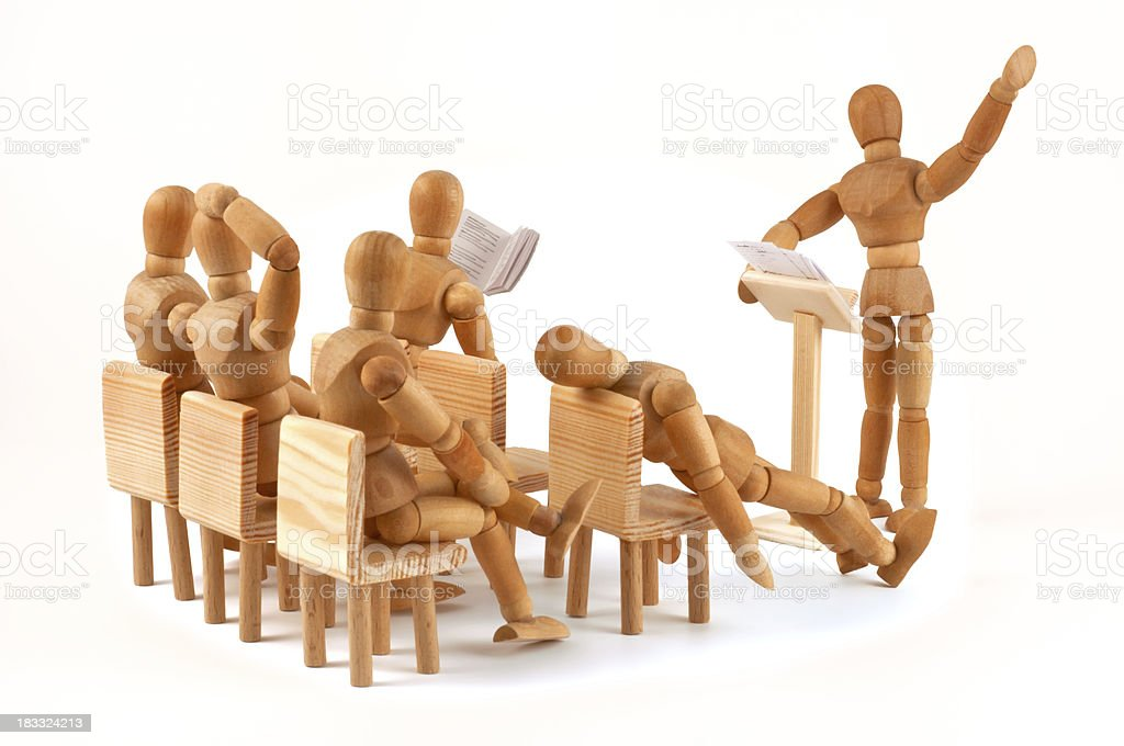 boring monologue of an enthusiastic speaker - wooden mannequin meeting royalty-free stock photo