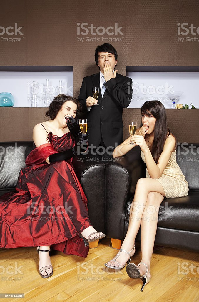 Boring party: three classy dressed party-goers yawning, bizarre setting royalty-free stock photo