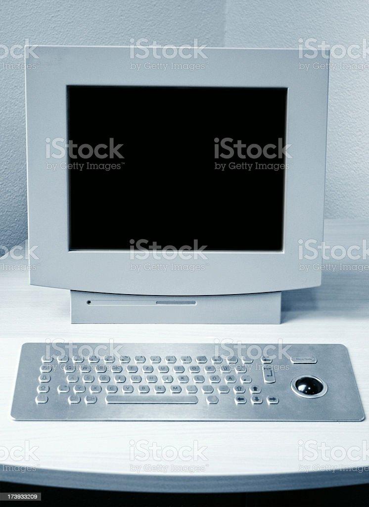 Boring white computer desktop and flat keyboard stock photo