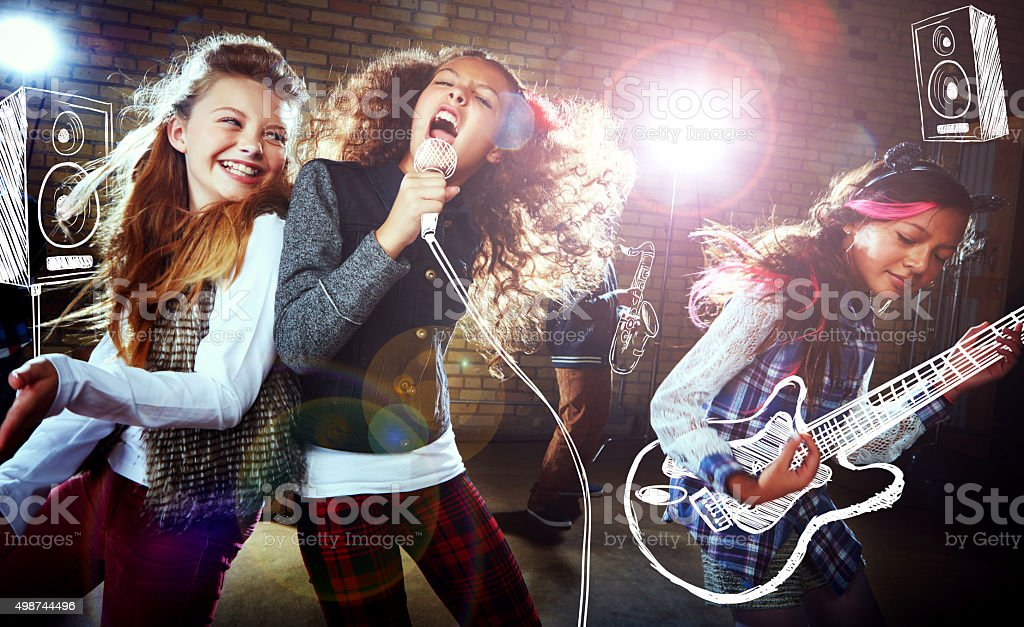 Shot of children singing and playing rock music on imaginary...