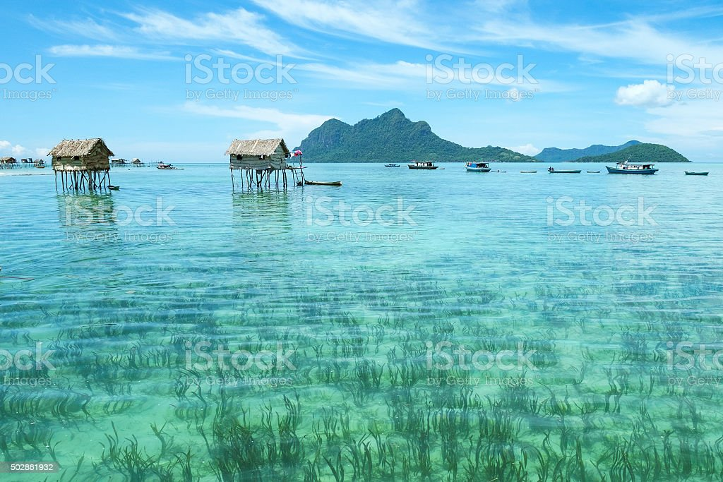 Borneo sea gypsy water village in Mabul Maiga. stock photo