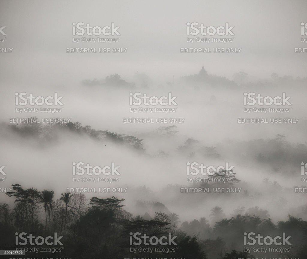 Borobodur temple fog at sunrise stock photo