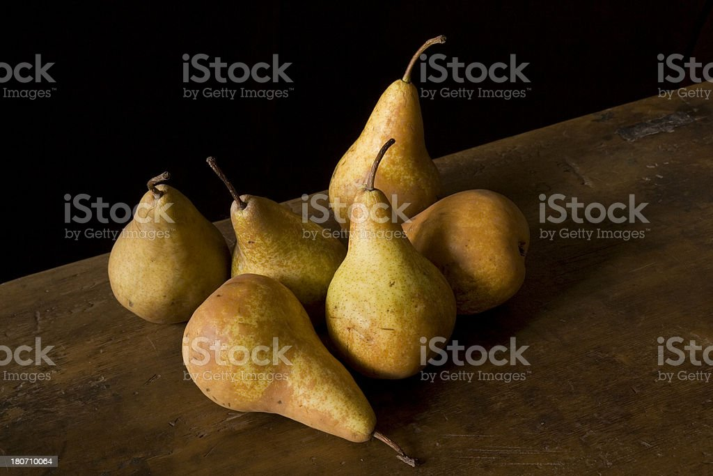 Bosc Pears on Wood Table stock photo