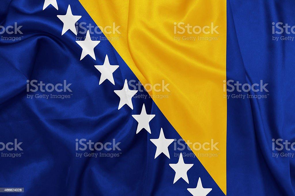 Bosnia and Herzegovina - Waving national flag on silk texture stock photo