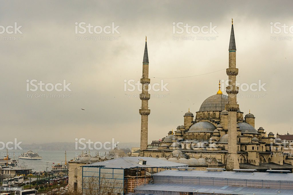 Bosphorus in Istanbul with the New Mosque or Yeni Cami. stock photo