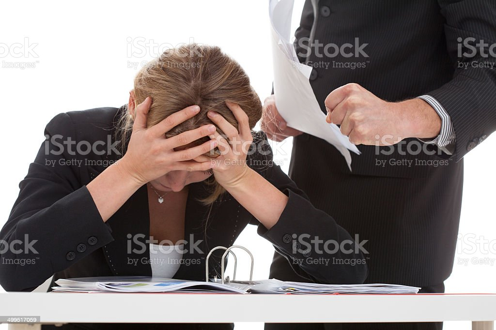 Boss bullying his employee stock photo