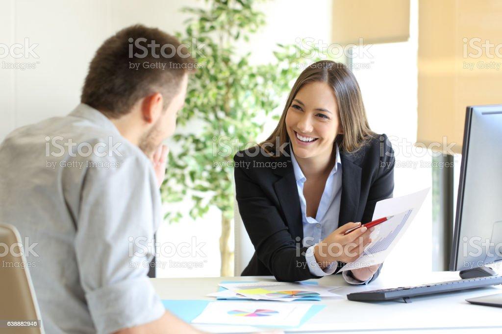 Boss celebrating a good job from an employee stock photo
