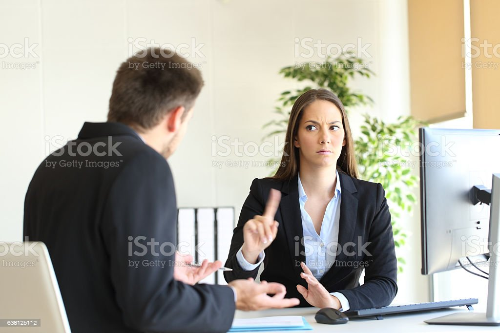 Boss denying something to an employee stock photo