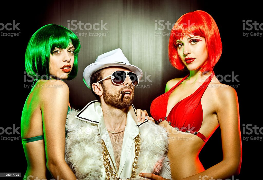 boss in fur with two girls red green bikini royalty-free stock photo