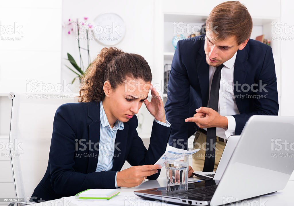 boss man accusing upset woman to making business failure stock photo