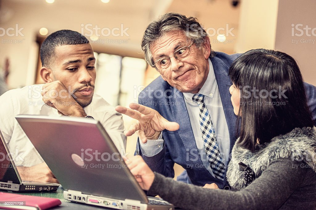 Boss not fully satisfied with his employee's work stock photo