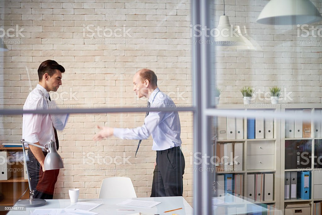 Boss scolding employee stock photo
