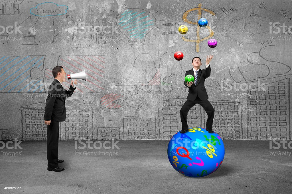 Boss using speaker yelling businessman juggling with currency sy stock photo