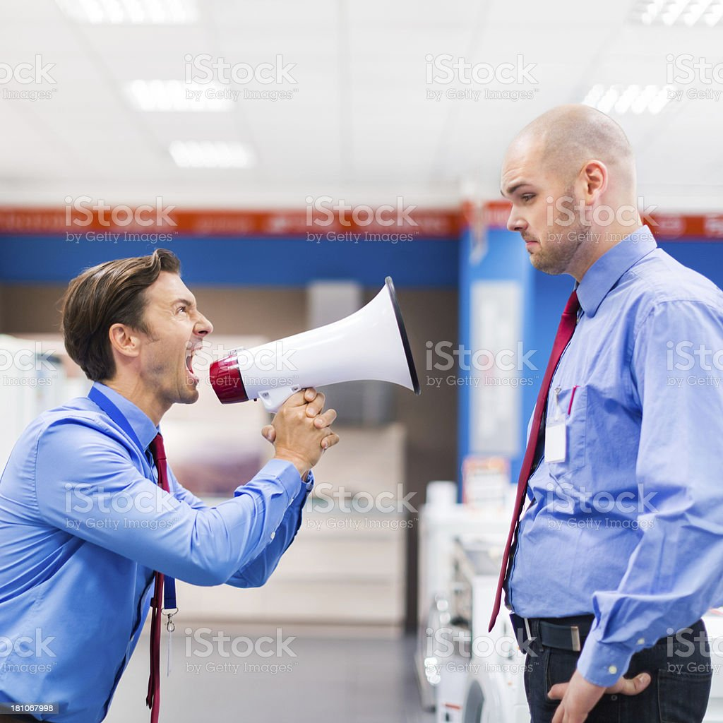 Boss With Megaphone Scolding An Employee stock photo