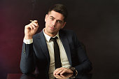 Boss with smirk smoking cigarette