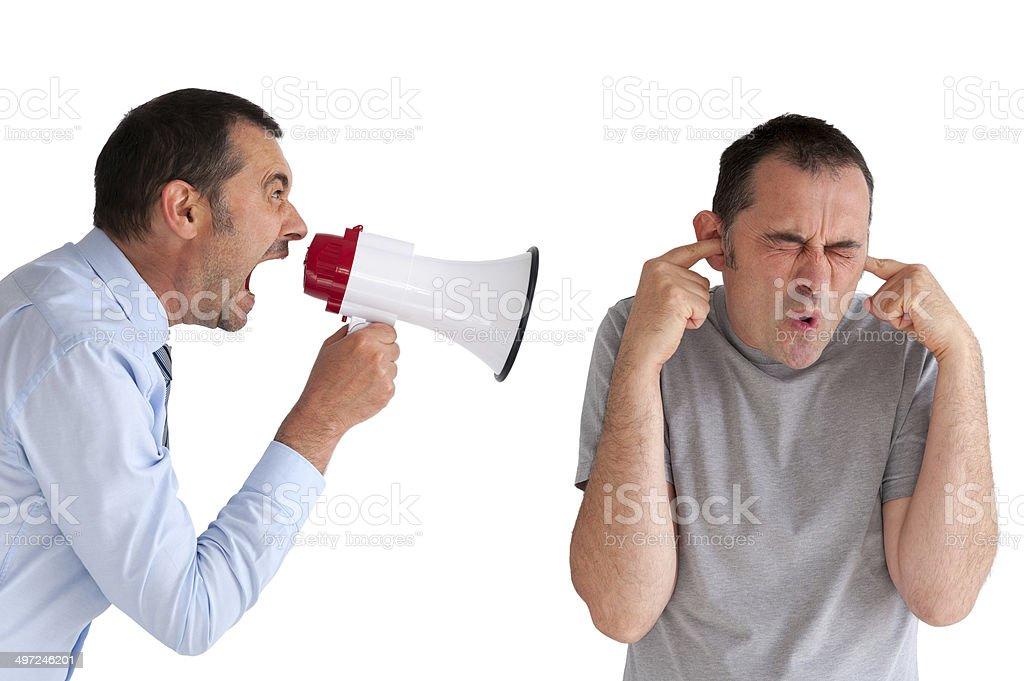 boss yelling at a subordinate megaphone stock photo
