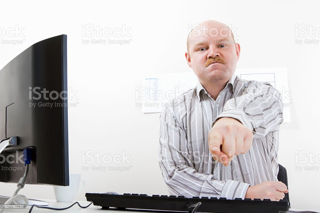 Bossy and angry Businessman Pointing At Camera stock photo