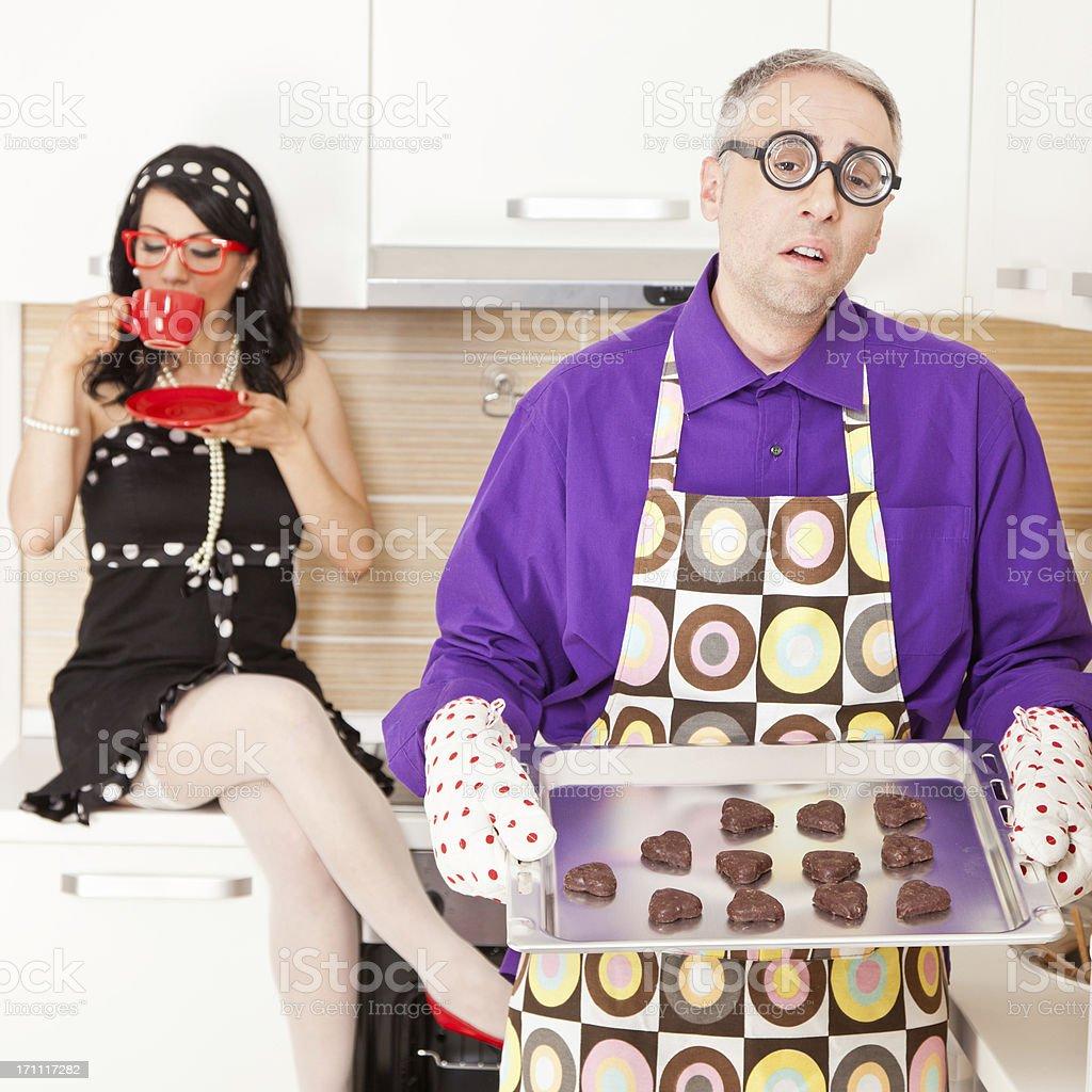 Bossy wife harassing her nerdy husband stock photo