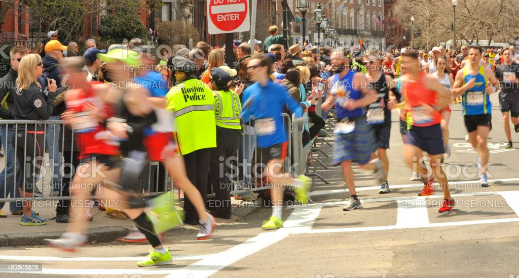 Boston 2013 Marathon runners @ Mile 26 with Boston Police stock photo