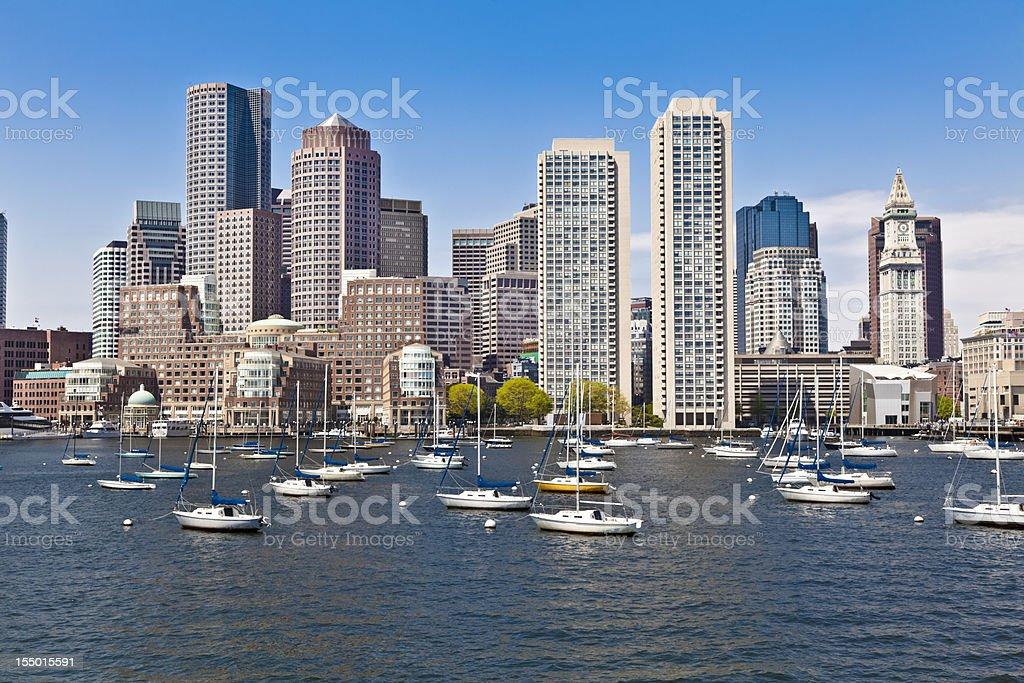 Boston Harbor Cityscape, Anchored Sailboats Under Blue Sky stock photo