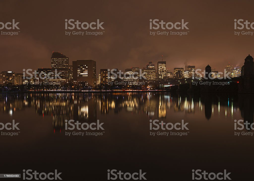 Boston skyline and reflection on the river at night royalty-free stock photo