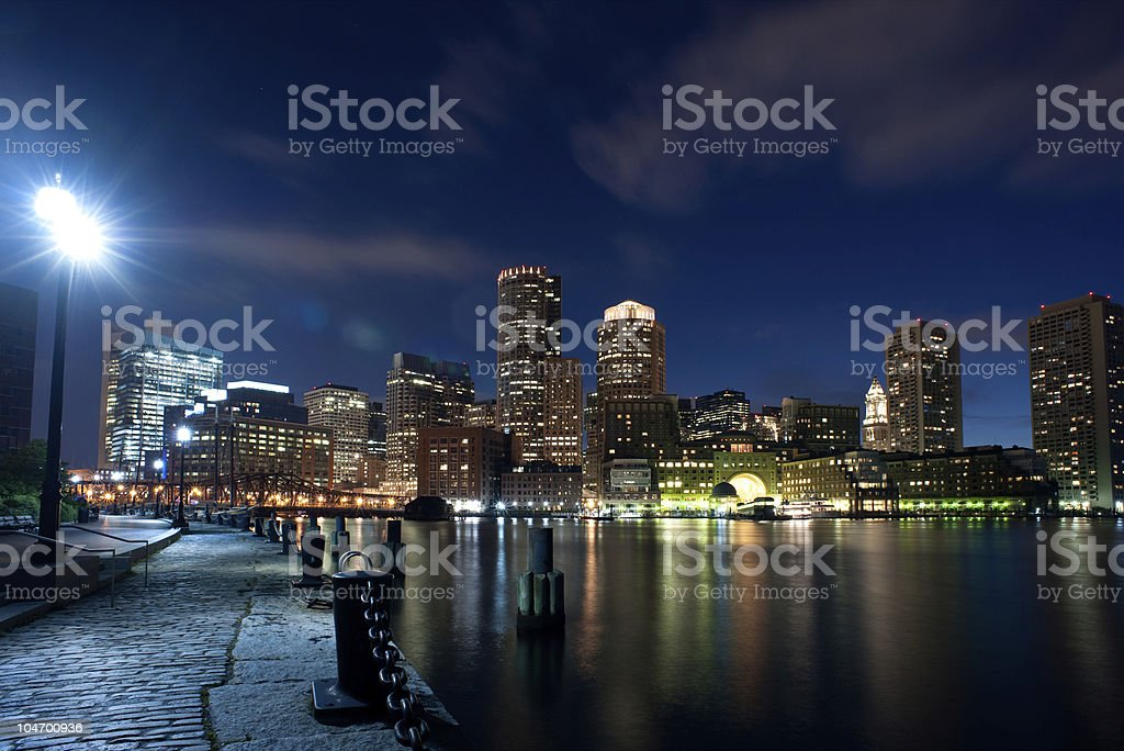 Boston skyline at night in horizontal royalty-free stock photo