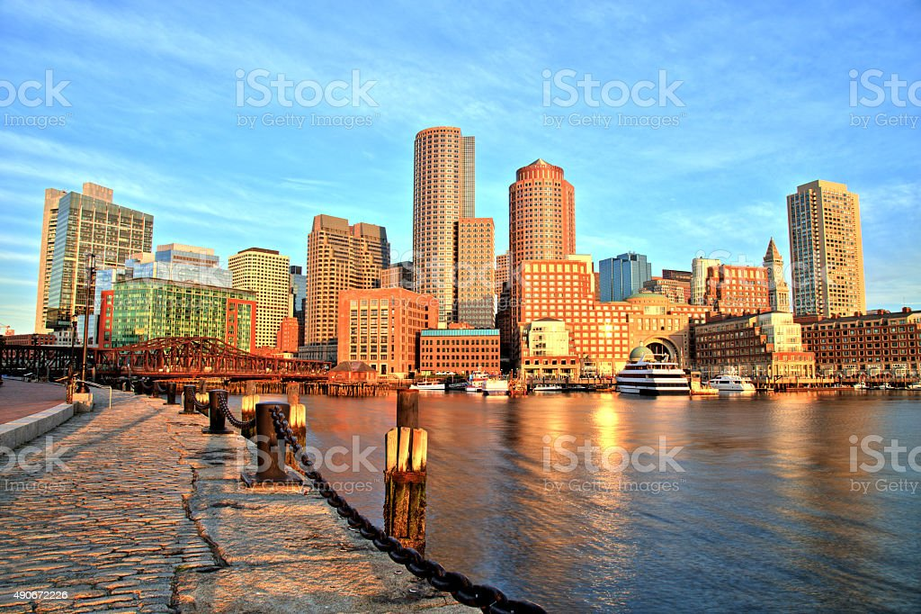 Boston Skyline with Financial District and Boston Harbor at Sunrise Panorama stock photo