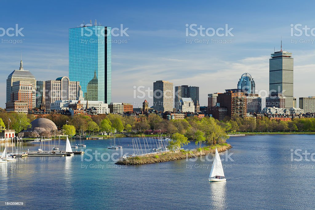 Boston skyline with sailing boats and skyscrapers royalty-free stock photo