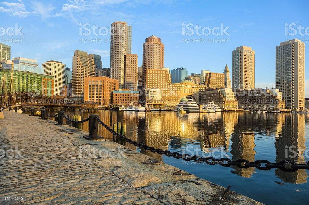 Boston Sunrise With Skyscraper Reflections on Glassy Harbor royalty-free stock photo