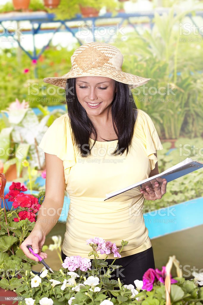 Botanist checking and recording in flower greenhouse royalty-free stock photo