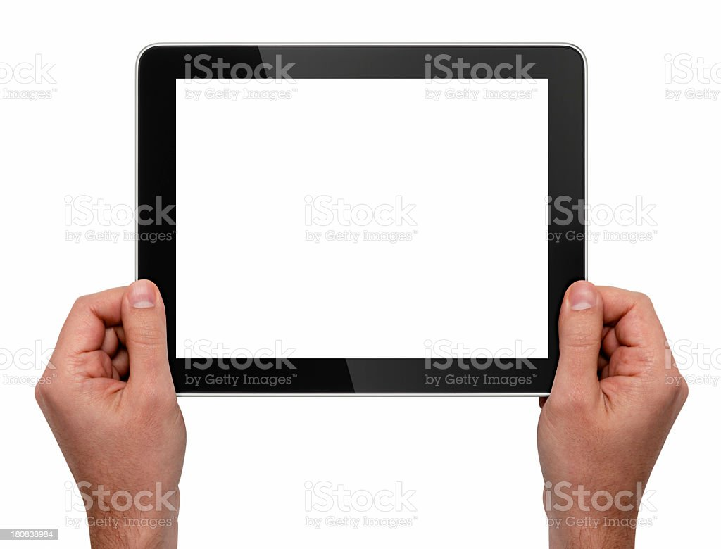 Both hands holding a tablet with blank white screen royalty-free stock photo