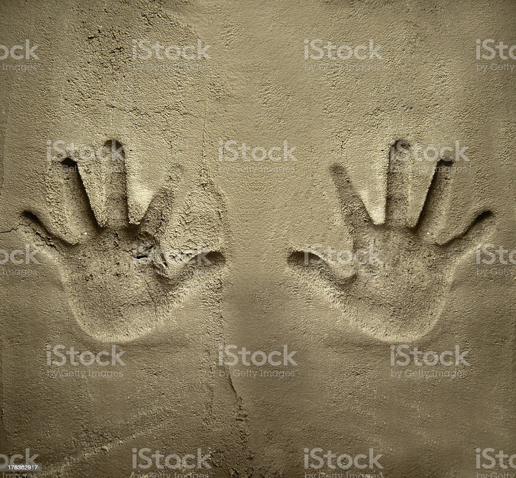 both hands print on cement mortar wall stock photo