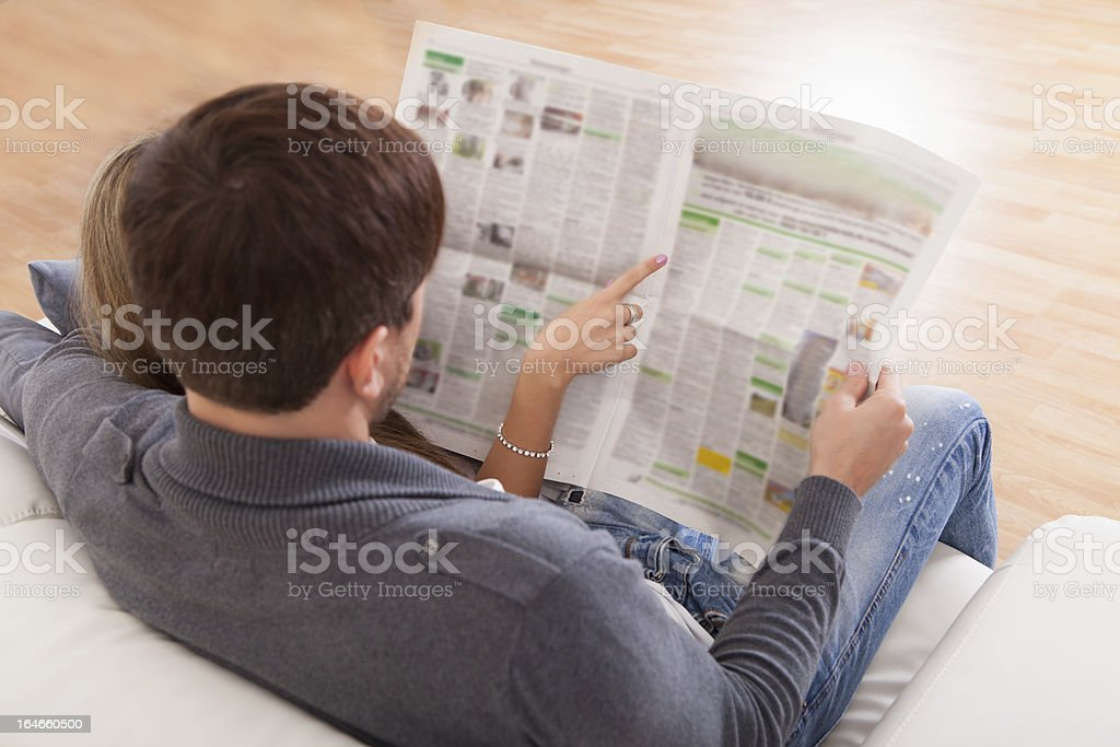 Both read article from newspaper royalty-free stock photo