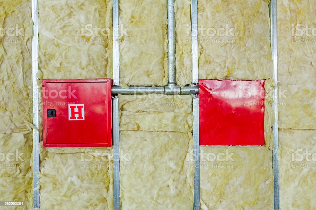 Both side of  fire hydrant cabinet in unfinished dividing wall stock photo