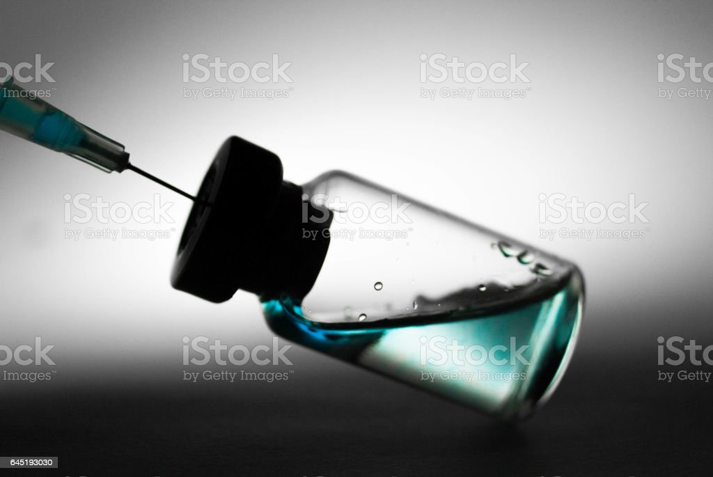 botle of medical injection and syringe stock photo