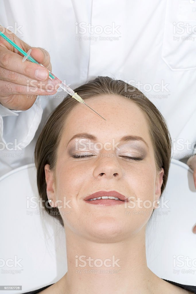 Botox injection into beautiful woman - eyes closed royalty-free stock photo
